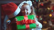 child-joy-boy-unwrap-christmas-present-sl-600×400